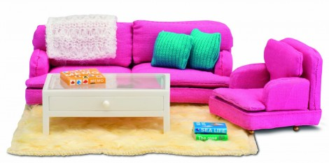 The ultra modern pink sitting room complete with coffee table and accessories.